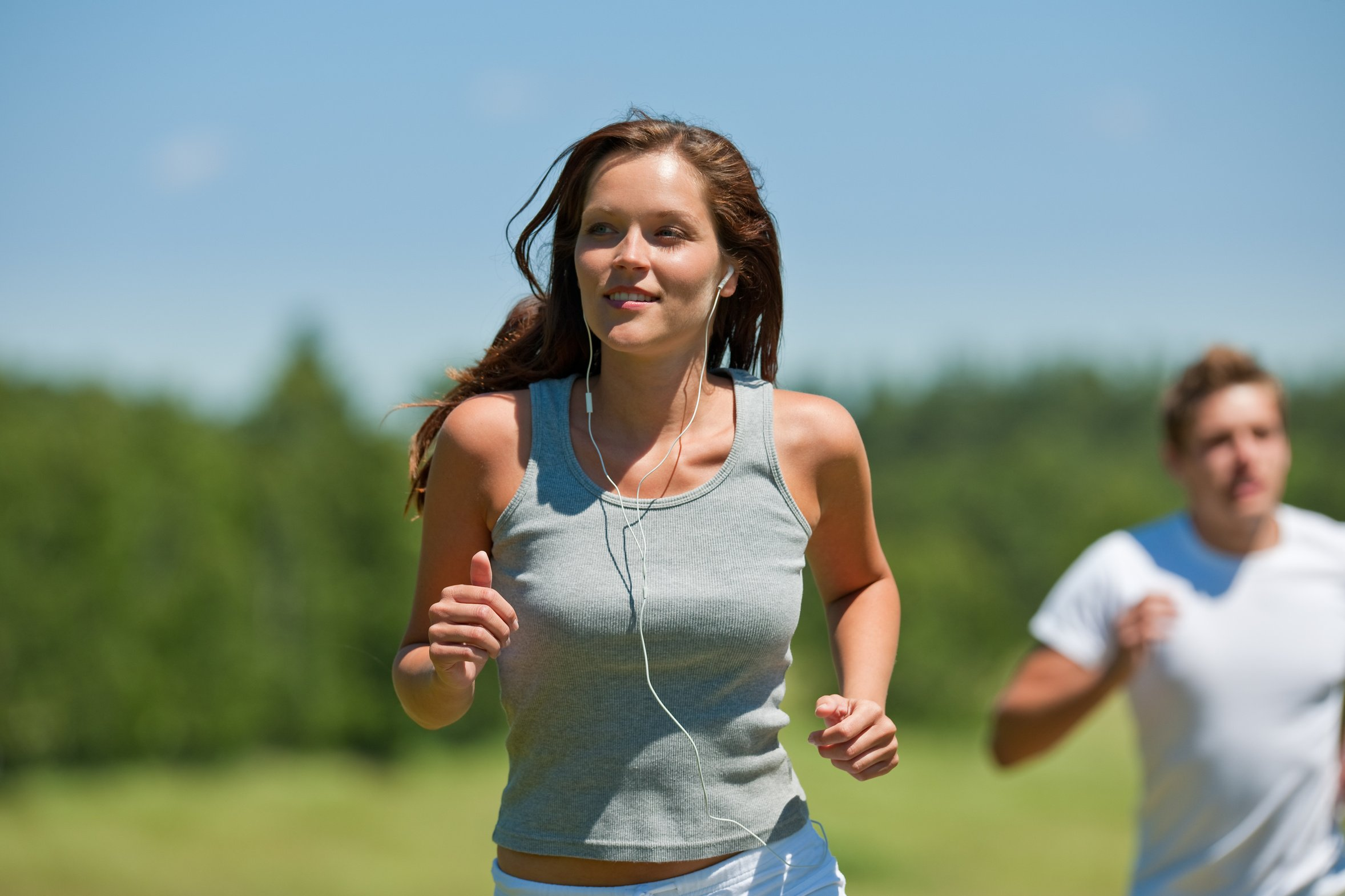 active-couple-headphones-healthy-jogging-man-meadow-music-nature-outdoors-people-running-sport-sportive-spring-summer-two-wellbeing-woman
